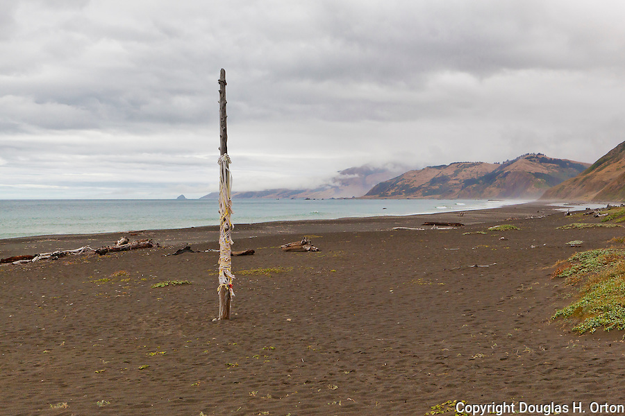A Maypole fades with time at expansive wide open beaches mark the Lost Coast and the King Range on the Northern California Pacific Coast.  Humboldt and Mendicino Counties.  A wild and scenic, roadless coastline near Humboldt Redwoods State Park via Mattoli Road over the King Range from U.S. 101.  Represented by www.spacesimages.com