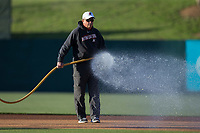 Kannapolis Intimidators head grounds keeper Billy Ball waters the infield prior to the game against the Lakewood BlueClaws at Kannapolis Intimidators Stadium on April 7, 2017 in Kannapolis, North Carolina.  The BlueClaws defeated the Intimidators 6-4.  (Brian Westerholt/Four Seam Images)