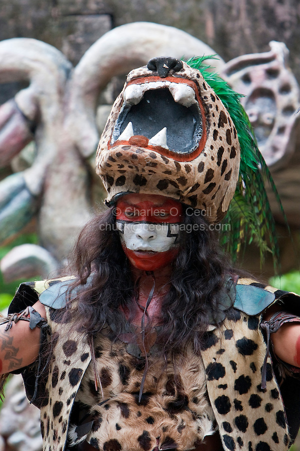 Mayan Dancer Representing Ek Balam (Jaguar), a warrior god, in pre-Hispanic Mayan Culture.  Xcaret, Riviera Maya, Yucatan, Mexico.
