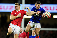 Dan Biggar of Wales under pressure in the air from Anthony Bouthier of France during the Guinness Six Nations Championship Round 3 match between Wales and France at the Principality Stadium in Cardiff, Wales, UK. Saturday 22 February 2020