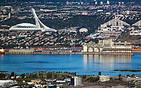 aerial photograph of Olympic Park, Montreal, Quebec, Canada viewed from Longueuil across the Saint Lawrence river. One of the twin Olympic Village structures is at right | photographie aérienne du Parc olympique, Montréal, Québec, Canada