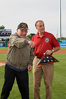 """World War II veteran, and Batavia Muckdogs fan, Roland R. """"Cappy"""" Cappiello throws out the ceremonial first pitch as Congressman Chris Collins looks on before a NY-Penn League game against the Auburn Doubledays on June 14, 2019 at Dwyer Stadium in Batavia, New York.  Batavia defeated 2-0.  (Mike Janes/Four Seam Images)"""