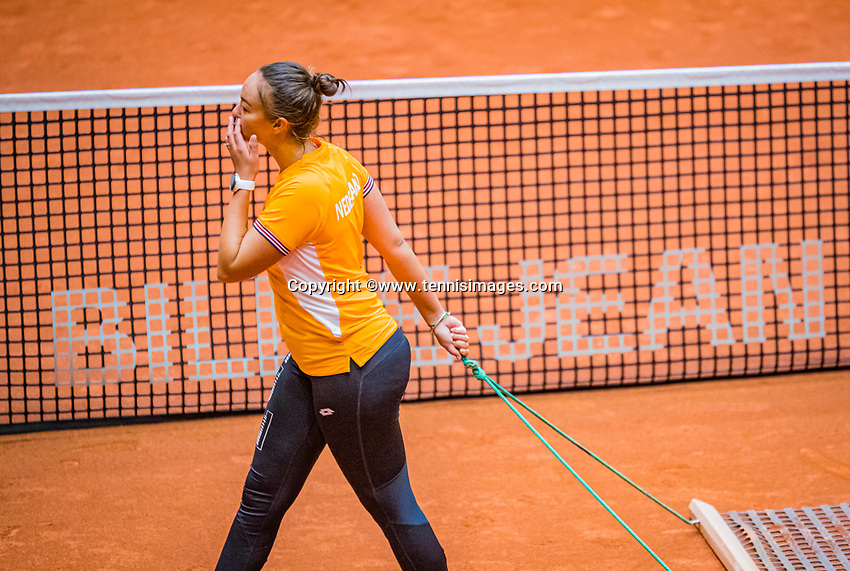 Den Bosch, The Netherlands, April 15, 2021,    Maaspoort, Billy Jean King Cup  Netherlands -  China : practice, Lesley Pattinama-Kerkhove (NED) swiping the court<br /> Photo: Tennisimages/Henk Koster
