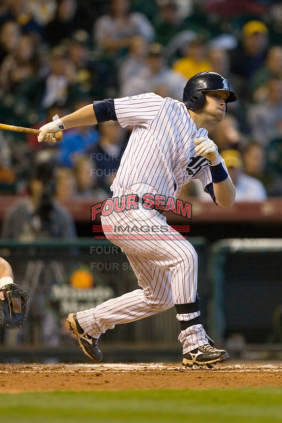 Jess Buenger #14 of the Rice Owls follows through on his swing versus the Baylor Bears in the 2009 Houston College Classic at Minute Maid Park March 1, 2009 in Houston, TX.  The Owls defeated the Bears 8-3. (Photo by Brian Westerholt / Four Seam Images)