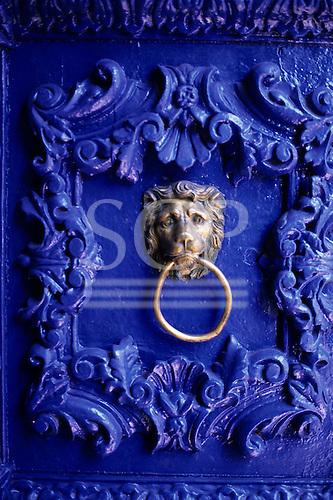 Cusco, Peru. Ornate blue painted door with lion knocker; Hotel Garcilaso.