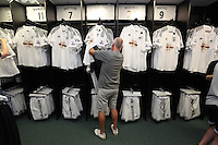 Pictured: A man goes through the new home kit shirts. Saturday 21 June 2014<br /> Re: Launch of the new home and away kit for Swansea City Football Club at the Liberty Stadium, south Wales.