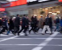 AVAILABLE FROM GETTY IMAGES FOR COMMERCIAL AND EDITORIAL LICENSING.   Please go to www.gettyimages.com and search for image # 135369275.<br /> <br /> Busy, Blurred Motion View of Commuters Crossing Street in Midtown Manhattan During the Evening Rush Hour, New York City, New York State, USA