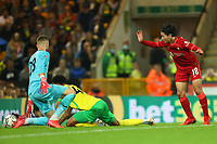 21st September 2021; Carrow Road, Norwich, England; EFL Cup Footballl Norwich City versus Liverpool; Takumi Minamino of Liverpool shoots and scores his second goal for 0-3 in the 80th minute