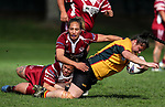 Geneva Webber fends the tackle of Atawhai Tupaea of Papakura. Premier Women's Rugby League, Papakura Sisters v Manurewa Wahine, Prince Edward Park, Auckland, Sunday 13th August 2017. Photo: Simon Watts / www.phototek.nz