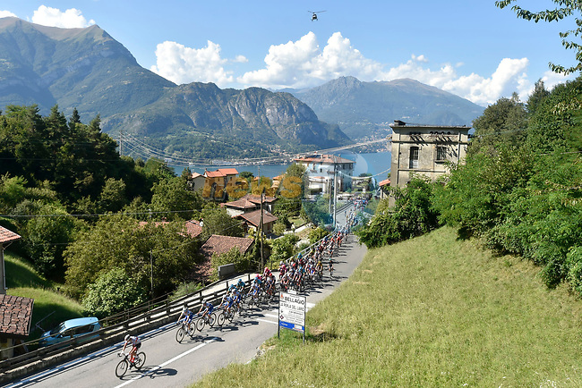 The peloton pass through Bellagio during the 114th edition of Il Lombardia 2020, running 231km from Bergamo to Como, Italy. 15th August 2020.<br /> Picture: LaPresse/Fabio Ferrari | Cyclefile<br /> <br /> All photos usage must carry mandatory copyright credit (© Cyclefile | LaPresse/Fabio Ferrari)