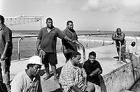 Republic of Nauru. Central Pacific. Nauru is a tiny island (21 square-km).  Nauru Phosphate Corporation. A group of seamen wait for the arrival of a ship which delivers diesel for both the power house and the dessalination plant. © 1999 Didier Ruef