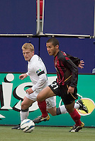 The MetroStars' Craig Ziadie is marked by New England Revolution's Joe Franchino. The New England Revolution played the NY/NJ MetroStars to a 1 to 1 tie at Giant's Stadium, East Rutherford, NJ, on April 24, 2004.