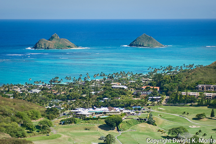 Mokulua Islands act as sentinnels, guarding the beach of Lanikai. Mid-Pacific Country Club clubhouse and golf course is in the foreground. Bluestone condominium community on the right.