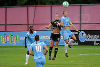 Brittany Bock (11) of the Los Angeles Sol and Keeley Dowling (17) of Sky Blue FC go up for a header. Sky Blue FC and the Los Angeles Sol played to a 0-0 tie during a Women's Professional Soccer match at Yurcak Field in Piscataway, NJ, on June 13, 2009.