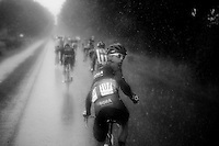 heavy rain beats upon the peloton and everybody (like Daniel Schorn of Bora-Argon 18 here) is looking for some extra rain jacket to be brought from the team cars<br /> <br /> stage 5: Eindhoven - Boxtel (183km)<br /> 29th Ster ZLM Tour 2015