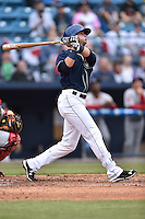 Asheville Tourists second baseman Forrest Wall (7) swings at a pitch during game one of a double header against the Greenville Drive on April 18, 2015 in Asheville, North Carolina. The Tourists defeated the Drive 2-1. (Tony Farlow/Four Seam Images)