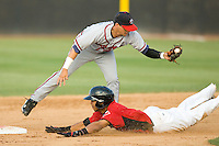Leury Garcia #3 of the Hickory Crawdads slides into second base ahead of the tag from Matt Weaver #9 of the Rome Braves at  L.P. Frans Stadium May 23, 2010, in Hickory, North Carolina.  The Rome Braves defeated the Hickory Crawdads 5-1.  Photo by Brian Westerholt / Four Seam Images