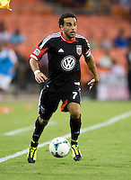 Dwayne De Rosario (7) of D.C. United brings the ball forward during a game at RFK Stadium in Washington, DC.  D.C. United tied Toronto FC, 1-1.