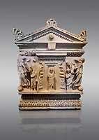 End panel of a Roman relief garland  sculpted sarcophagus, style typical of Pamphylia, 3rd Century AD, Konya Archaeological Museum, Turkey. Against a grey background