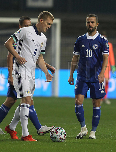 8th October 2020, Sarajevo Bosnia; European International Football Championships playoff,  Bosnia and Herzegovina versus Northern Ireland;  Miralem PjanicR Bosnia and Herzegovina watches as George Saville of Northern Ireland controls the play