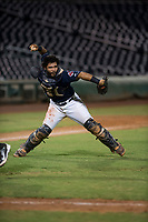 AZL Indians 2 catcher Felix Fernandez (9) throws to first base during an Arizona League game against the AZL Dodgers at Goodyear Ballpark on July 12, 2018 in Goodyear, Arizona. The AZL Indians 2 defeated the AZL Dodgers 2-1. (Zachary Lucy/Four Seam Images)