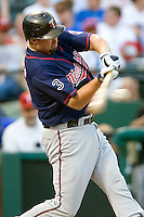 Minnesota Twins first baseman Michael Cuddyer #5 connects on a fourth inning solo home run during a Major League Baseball game against the Texas Rangers at the Rangers Ballpark in Arlington, Texas on July 27, 2011. Minnesota defeated Texas 7-2.  (Andrew Woolley/Four Seam Images)