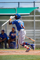 GCL Mets shortstop Ronny Mauricio (2) follows through on a swing during a game against the GCL Cardinals on August 6, 2018 at Roger Dean Chevrolet Stadium in Jupiter, Florida.  GCL Cardinals defeated GCL Mets 6-3.  (Mike Janes/Four Seam Images)