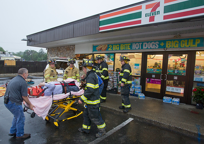 Rescue personnel wheel away Stephan J. Dougherty, 61, of Dunmore, Pa., after he was extricated from the Chevy Suburban he crashed through the front wall and windows of the 7-11 on Rt. 71 in Manasquan Friday evening. According to a report on The Coast Star's website, police charged Dougherty with driving under the influence of alcohol, driving under the influence of alcohol in a school zone, having an open container of alcohol in a motor vehicle, consumption of alcohol in a motor vehicle, reckless driving and careless driving and an assortment of other motor vehicle violations.   6/7/13  photo by Andrew Mills
