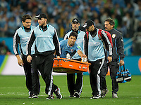 Luis Suarez of Uruguay is taken off by medics on a stretcher
