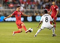 KANSAS CITY, KS - JUNE 26: Cristian Roldan #15 attacks with Marcos Sanchez #8 defending during a game between Panama and USMNT at Children's Mercy Park on June 26, 2019 in Kansas City, Kansas.