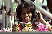 Rio de Janeiro, Brazil. Carnival; mixed race woman with sequin necklace choker and pink carnival costume dress.