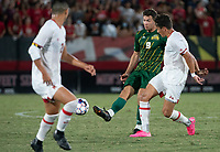 COLLEGE PARK, MD - SEPTEMBER 3: George Mason University forward Balint Kocso (9)passes away from Maryland University midfielder Malcolm Johnson (11) during a game between George Mason University and University of Maryland at Ludwig Field on September 3, 2021 in College Park, Maryland.