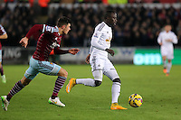 Pictured: Modou Barrow of Swansea (R) Saturday 10 January 2015<br /> Re: Barclays Premier League, Swansea City FC v West Ham United at the Liberty Stadium, south Wales, UK