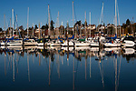 Bellingham Bay Marina with yachts and sailboats moored with reflections in still water