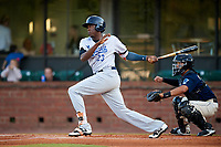 Pensacola Blue Wahoos left fielder Gabriel Guerrero (23) follows through on a swing in front of catcher Francisco Arcia (32) during a game against the Mobile BayBears on April 25, 2017 at Hank Aaron Stadium in Mobile, Alabama.  Mobile defeated Pensacola 3-0.  (Mike Janes/Four Seam Images)