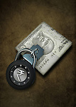 Conceptual shot of combination lock on Indian banknote