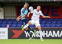 Will De Havilland  of Wycombe Wanderers wins the header during the Friendly match between Aldershot Town and Wycombe Wanderers at the EBB Stadium, Aldershot, England on 26 July 2016. Photo by Alan  Stanford.