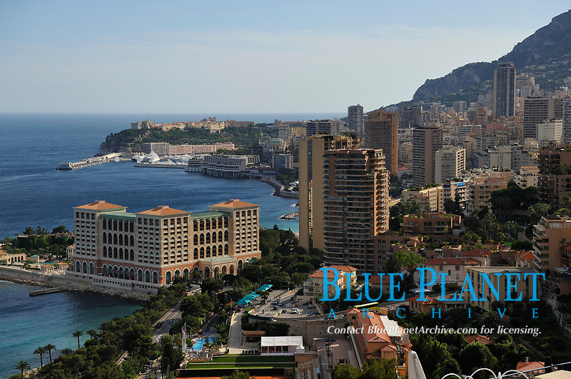 """View on the Principality of Monaco, Mediterranean Sea. The photo shows the Port Nikolas Flores harbour in the Condamine ward.the Monte Carlo ward is the principal residential and resort area with the casino. Monaco-Ville ward is the old city which is on a rocky promontory known as Rock of Monaco (in French """"Le Rocher""""). Monaco is the second smallest country in the world after Vatican City."""