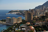 "View on the Principality of Monaco, Mediterranean Sea. The photo shows the Port Nikolas Flores harbour in the Condamine ward.the Monte Carlo ward is the principal residential and resort area with the casino. Monaco-Ville ward is the old city which is on a rocky promontory known as Rock of Monaco (in French ""Le Rocher""). Monaco is the second smallest country in the world after Vatican City."