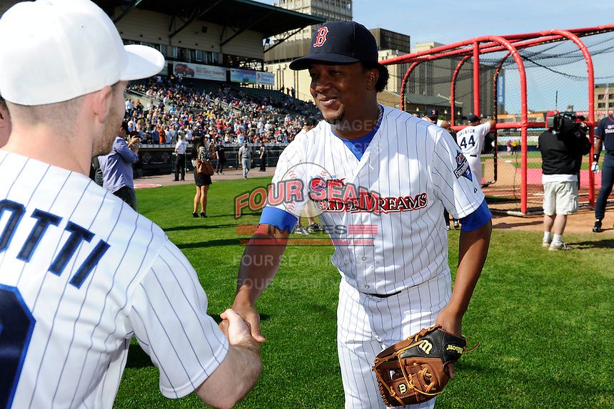 Former Boston Red Sox pitcher Pedro Martinez #45 shakes hands with contest winners before the MLB Pepsi Max Field of Dreams game on May 18, 2013 at Frontier Field in Rochester, New York.  (Mike Janes/Four Seam Images)