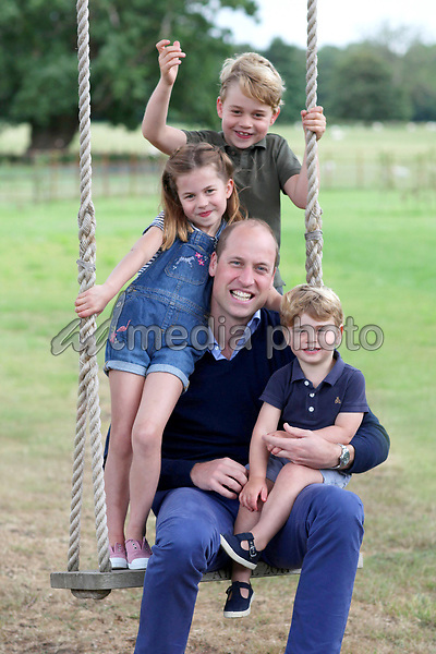 21 June 20120 - Undated photo released by Kensington Palace, which was taken by Kate Duchess of Cambridge Katherine Catherine Middleton earlier this month in Norfolk, of Prince William Duke of Cambridge, Prince George, Princess Charlotte and Prince Louis in new pictures marking both his birthday and Father's Day. The Duke of Cambridge turns 38 on Sunday. Photo Credit: ALPR/AdMedia
