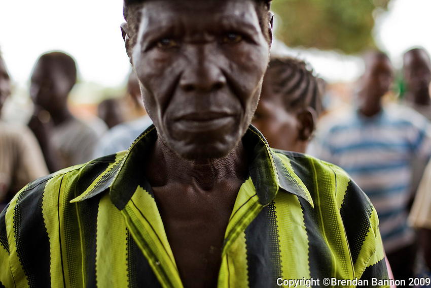 A group fo refugees in the moments after they arrived at Nyori refugee camp in South Sudan. they fled after LRA attacked neighboring villages in South Sudan In June 2009.