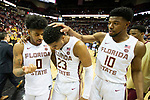 Florida State guard Rayquan Evans (0) and forward Malik Osborne (10) congratulates Florida State guard M.J. Walker (23) after an NCAA college basketball game in Tallahassee, Fla., Saturday, Feb. 15, 2020. Florida State defeated Syracuse 80-77.  (AP Photo/Mark Wallheiser)