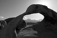 """Mobius Arch, in California's Alabama Hills State Recreation Area forms a portal to view  Lone Pine Peak and Mount Whitney. Since the 1920's film makers have been using the Alabama Hills as a backdrop for their movies. In the early days of motion pictures films such as """"Gunga Din"""", """"How the West Was Won"""", and """"Yellow Sky"""" were filmed at a site within the recreation area known as """"Movie Flats. More recently movies such as """"Tremors"""", """"Star Trek Generations,"""" """"Gladiator"""", """"Iron Man"""", and """"Django Unchained"""" were shot in the Alabama Hills."""
