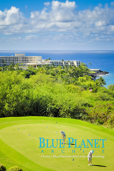 Kona Country club practice putting green, The Sheraton resort in the distance, Keauhou Bay, The Big Island of Hawaii