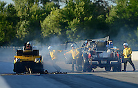 Sept 8, 2012; Clermont, IN, USA: NHRA funny car driver Bob Bode exits his funny car through the roof hatch after a fire as the Safety Safari comes to extinguish the flames during qualifying for the US Nationals at Lucas Oil Raceway. Mandatory Credit: Mark J. Rebilas-