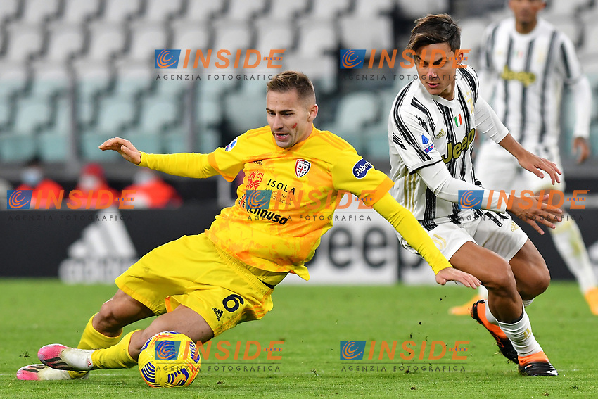 Marko Rog of Cagliari Calcio and Paulo Dybala of Juventus FC compete for the ball during the Serie A football match between Juventus FC and Cagliari Calcio at Allianz stadium in Torino (Italy), November21th, 2020. Photo Giuliano Marchisciano / Insidefoto