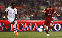 Calcio, Serie A: Roma vs Milan. Roma, stadio Olimpico, 25 aprile 2014.<br /> AS Roma forward Francesco Totti kicks the ball as AC Milan midfielder Sulley Ali Muntari, of Ghana, left, challenges him during the Italian Serie A football match between AS Roma and AC Milan at Rome's Olympic stadium, 25 April 2014.<br /> UPDATE IMAGES PRESS/Riccardo De Luca