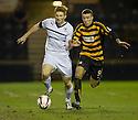 Raith Rovers' Jason Thomson and Alloa's Edward Ferns challenge for the ball.