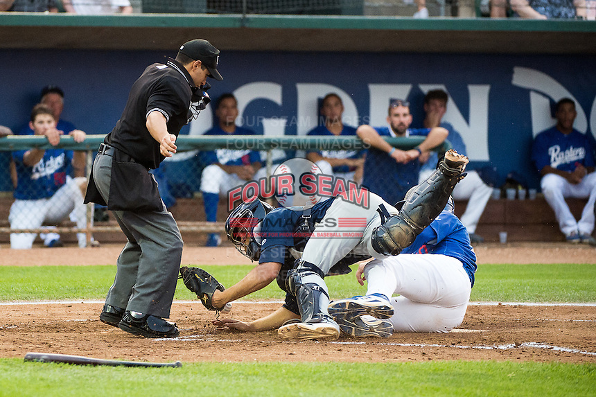 Matt Jones (40) of the Ogden Raptors slides into home plate as Helena Brewers catcher Milan Post (12) tries to place the tag and home plate umpire Ricardo Estrada watches the play in Pioneer League action at Lindquist Field on August 19, 2015 in Ogden, Utah. Ogden defeated Helena 4-2. (Stephen Smith/Four Seam Images)